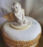 Торт с красивой фигуркой ангелочка